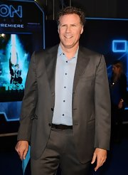 Will Ferrell posed in a gray pinstriped blazer.