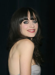 Zooey Deschanel opted for a fashion forward beauty look with heavy liner, dark shadow and false feathery lashes only applied to her bottom lids.