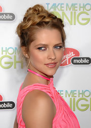 Actress Teresa Palmer attended the premiere of 'Take me home tonight' sporting a braided bun. Her woven locks were wrapped around the crown of her head and pinned into place.