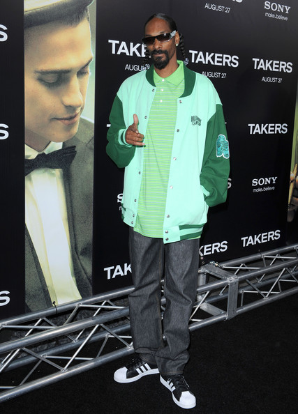 Snoop Dogg showed his school pride in a mint and forest green wool letterman jacket.