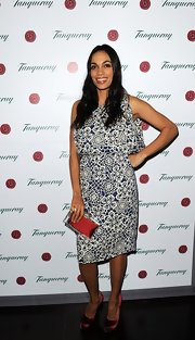 Rosario Dawson chose a retro-style floral dress for her evening look at the Tanqueray Gin Palace.