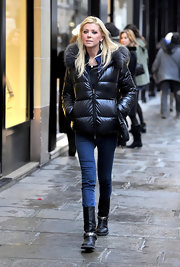Tara Reid strolled through Paris in black motorcycle boots.