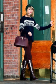 Taylor Swift kept herself warm in a printed sweater while out and about.
