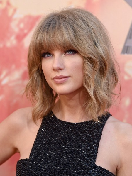 Taylor Swift Medium Wavy Cut with Bangs [hair,blond,hairstyle,human hair color,beauty,layered hair,bangs,chin,fashion model,long hair,iheartradio music awards,red carpet,hair,hairstyle,hairstyle,bob cut,human hair color,beauty,shrine auditorium,los angeles,taylor swift,hairstyle,short hair,bob cut,updo,hair,fashion,model,celebrity,bangs]