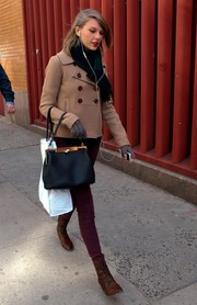 Taylor Swift showed off her cute winter style with this nude pea coat and maroon skinnies combo while out on a stroll.