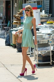 Taylor Swift stepped out looking adorably stylish in a printed green mini dress with side cutouts, which she contrasted with killer magenta peep-toes.