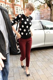 Taylor's burgundy cigarette pants perfectly displayed her darling bowed flats.