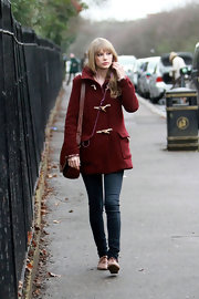 Taylor Swift kept a low profile at the zoo in a maroon toggle coat and skinny jeans.