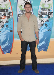 A guy can never go wrong with a classic button down shirt. Chace paired his dark wash jeans with a tan shirt equipped with double front pockets.