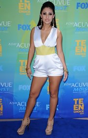 Francia Raisa donned a white silk jersey draped jumper with a lambskin chartreuse waistband for the Teen Choice Awards.
