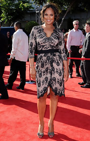 Laila Ali opted for an ultra-feminine look at the 2011 ESPYS in a flattering lace wrap dress and gray bow-adorned peep-toes.