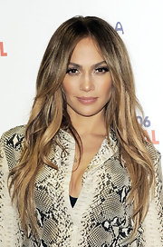 Jennifer Lopez styled her highlighted locks into a layered straight cut at the Summertime Ball in London. A classic center part completed her sleek look.