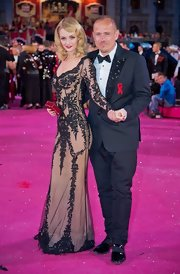 Lydia Hearst arrived at the 20th Annual Life Ball carrying a red crystal Kiosque clutch.