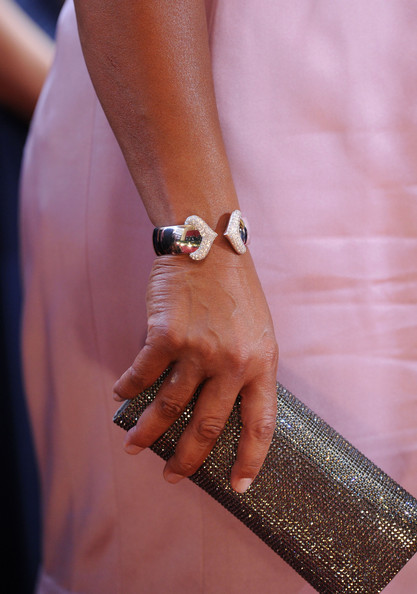 The Queen perfectly matched her crystal clutch to this cuff crystal bracelet. Perfect.