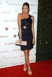 Brittany Binger matched her leg-lengthening nude pumps to a sleek patent clutch.