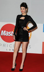 Victoria topped off her daring mini dress with embellished platform pumps.