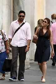 Abhishek Bachchan went shopping in Rome wearing gray linen slacks and a pink button-down.