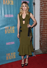 Suki Waterhouse was modern and edgy in a harness-embellished army-green cutout dress by David Koma at the premiere of 'The Bad Batch.'