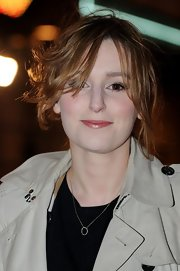 Laura Carmichael arrived at the press night of 'Book of Mormon' with her hair tied up in a messy updo.