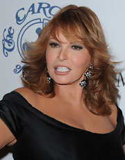 Raquel Welch wore a pair of decorative earrings with gemstone embellishments to accessorize her 16th Carousel of Hope outfit.