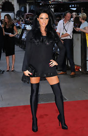 Katie went for a vixen-esque look on the red carpet in a long-sleeved mini wtih fitted, over the knee boots.