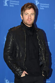 Ewan looked slick in a zip-up leather jacket over an all-black ensemble.