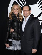 Taylor Armstrong carried a petite black snakeskin clutch on the red carpet.