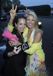 Christie shows off her hot pink gemstone clutch which has a cute peace sign encrusted on it.