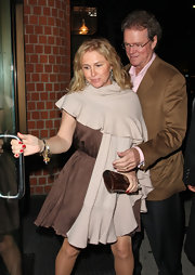 Kathy Hilton layered a beige shawl over her brown cocktail dress for a demure look.