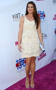 Brooke looked fun and flirty in this off-white lace frock.