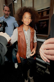 Jaden loves to wear vests! Here the young star rocks a leather zip up vest in a tan color.