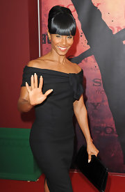Jada Pinkett paired her off-the-shoulder dress with a french twist updo and bangs.