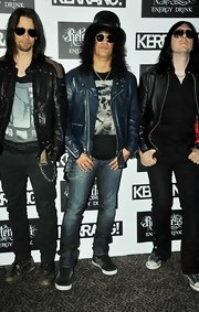 Slash paired washed-out jeans with a leather jacket for his Kerrang! Awards look.