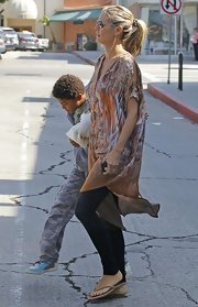 Heidi went boho in this silky print kaftan for a casual outing with her fam.