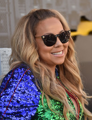 Mariah Carey attended the premiere of 'The Lego Batman Movie' wearing her hair in half-up waves.