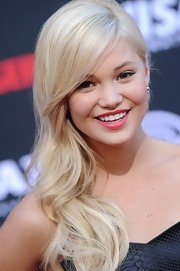 Olivia Holt looked very ladylike at the 'Lone Ranger' premiere wearing her platinum-blonde locks in a romantic side sweep.