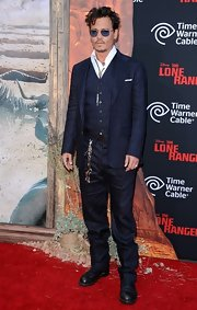 Johnny Depp cleaned up (without really losing his trademark edginess) in a striped navy three-piece suit for the premiere of 'The Lone Ranger.'