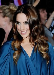 Mel C oozed romance with this long wavy cut at the Pride of Britain Awards.