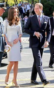 Prince William wore a crisp navy suit with a mauve tie. Black patent oxfords completed his suave look.