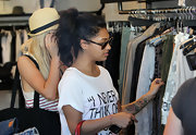 Vanessa showed off her flower tattoo on her forearm while doing some shopping.