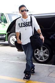"Mike ""The Situation"" Sorrentino's wears a white t-shirt emblazoned with the word ""Blessed."" The reality star has a lot to feel blessed for, especially the $5 million he's expected to make this year alone!"