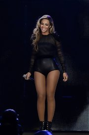 Beyonce rocked a black leather bodysuit that featured black silk tulle, long sleeves, and black crystals on the shoulders.