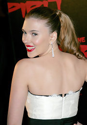 Scarlett's hair is pulled back into a sleek covered ponytail. The ends are softly curled for an extra girlie touch.