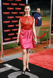 Rebecca gets gutsy in this bright red and pink cocktail dress at 'The Town' premiere in Boston.