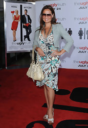 Tia Carrere went to the premiere of 'The Ugly Truth' carrying a stylish snakeskin tote.