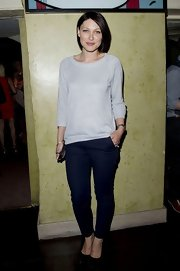 Emma Willis paired her gray sweater with a pair of dark navy skinny pants.