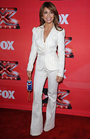 Paula Abdul streamlined her figure in a white pinstriped pantsuit.