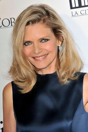 Michelle Pfeiffer wore a tousled high-volume wavy 'do when she attended the opening of Cite du Cinema.