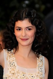 Audry Tautou attended the premiere of 'Therese Desqueyroux' wearing her rich brown tresses in tousled Marcel waves.