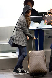 Ashley Tisdale made her way through LAX with her monogrammed Louis Vuitton Pegase suitcase.